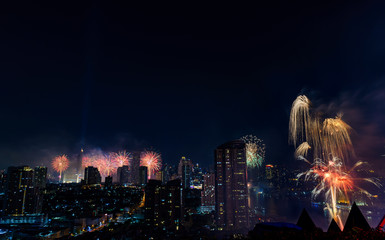 Celebration fireworks in the city at night time. landscape of Bangkok City. Thailand.