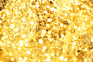 The golden LED light bokeh blurred abstract pattern background.