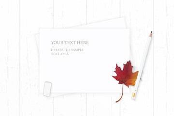 Flat lay top view elegant white composition paper nature autumn maple leaf and pencil eraser on wooden background