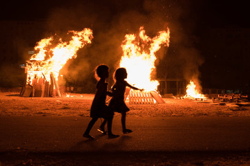 Little jewish religious girlsdo bonfire at Jewish holiday of Lag Baomer