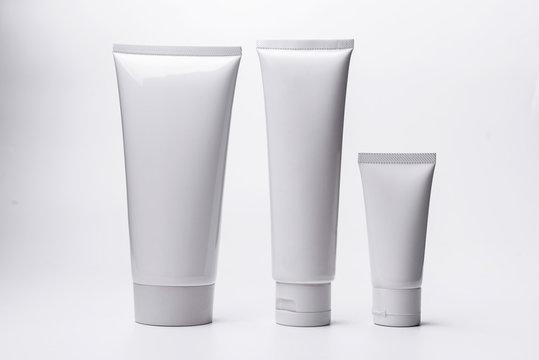 Blank white cosmetic tube isolated on white background.