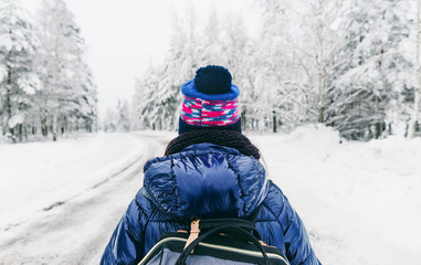 Travel Lifestyle Sweden Young woman backpack winter snowy road
