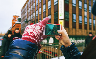 Travel lifestyle. woman taking pictures friends treet Stockholm winter