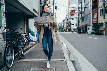 tourist holding travel map in osaka city japan.