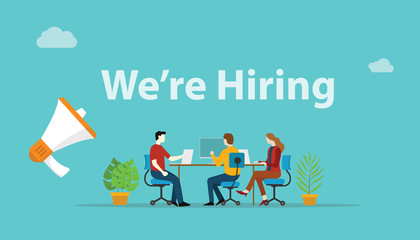 we are hiring recruitment concept with megaphone and team employee working together at office