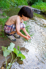 boy near the stream