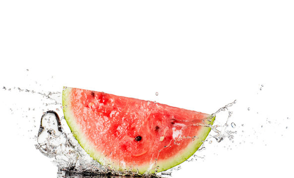Red watermelon with water splash isolated on white background