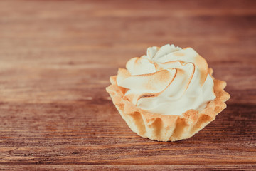 Sweet cupcake with whipped cream.