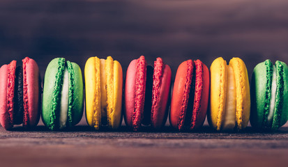 Macaroons of different colors in a row.