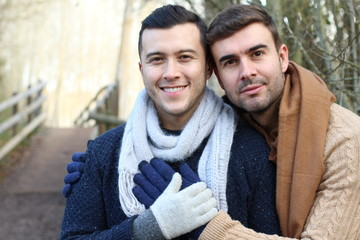 Homosexual couple outdoors with copy space