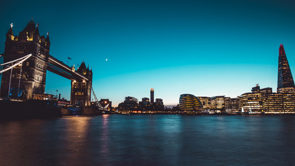 Panoramic view modern London city skyline River Thames sunset night