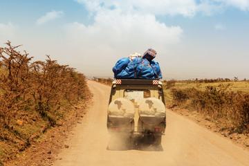 Safari cars on game drive in Serengeti National Park.