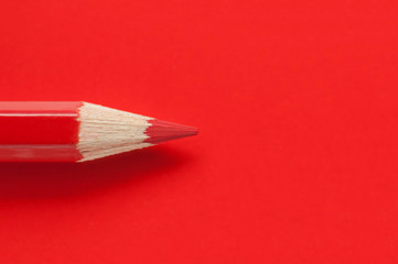 Macro photo of red pencil on red paper