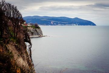 Gelendzhik. Coast. Steep coast, sea, rocks, trees. Breathtaking. Black sea, horizon, mountains, calm.