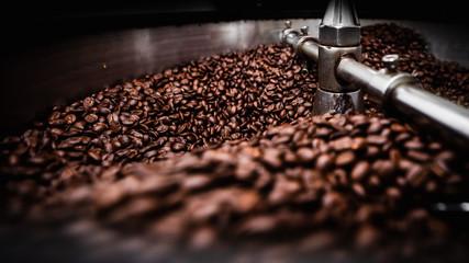 coffee roasting machine and brown coffee beans Fototapete