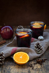 Two glasses of mulled wine with orange slices at Christmas time