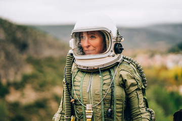 Portrait of woman in space suit exploring nature