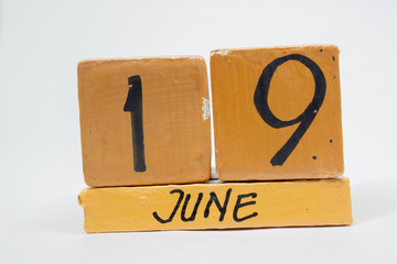 june 19th. Day 19 of month, handmade wood calendar isolated on white background. summer month, day of the year concept