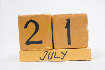 july 21st. Day 20 of month, handmade wood calendar isolated on white background. summer month, day of the year concept
