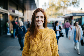 Portrait of a red-haired woman in the city