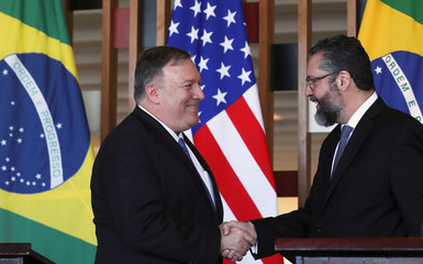 Brazil's Foreign Minister Ernesto Araujo shakes hands with U.S. Secretary of State Mike Pompeo at Itamaraty Palace in Brasilia
