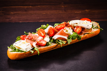 Long sandwich on black stone plate