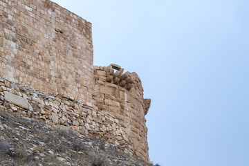 Fragment of the Corner tower in the medieval fortress Ash Shubak, standing on a hill near Al Jaya city in Jordan