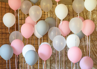 White, pink and gray pastel helium balloons, copy space. Holiday concept. Wedding, birthday, Christmas, Valentine day