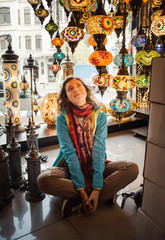 Travel to Turkey. Woman see on traditional light lamp