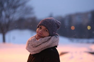 woman playing snow outside season winter clothes