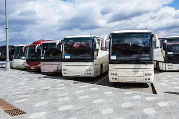 buses on parking on the background of cloudy sky