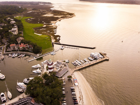Aerial view of Hilton Head with lighthouse, beach, and golf course.
