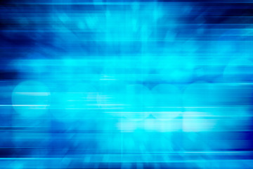 digitally generated image of blue light and stripes moving fast over blue background