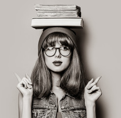 Portrait of young style hipster girl with books . Image in black and white color style