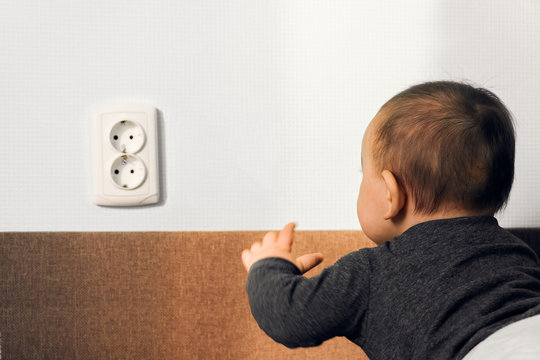 child crawl put fingers electric socket wall outlet hazard danger safety home