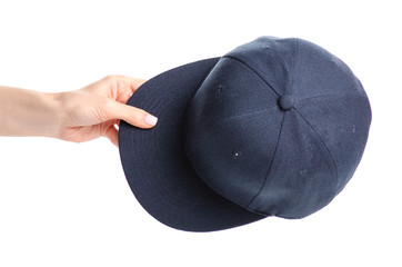 Blue cap in hand on a white background. Isolation