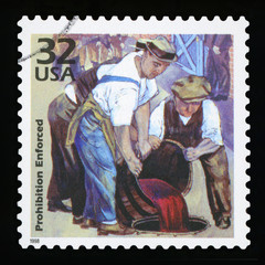UNITED STATES OF AMERICA - CIRCA 1998: a postage stamp printed in USA showing three men throwing alcohol during prohibition, CIRCA 1998.