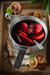 Tasty and homemade mulled red wine with cloves and anise