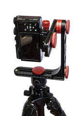 panoramic head for a tripod for the making of virtual tours and full seamless 360 degrees angle panoramas without parallax and distortion isolated on white background with mirrorless camera