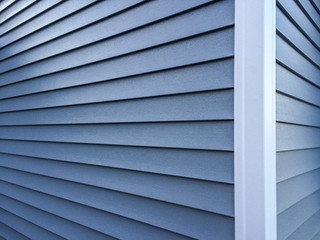Blue vinyl siding with white trim on the outside wall of a new home Wall mural