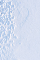 Abstract patterns on wind blown snow surface.