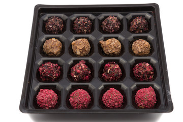 candy box with various color truffles in it