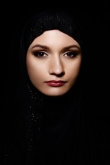 Young Arabian Muslim woman in hijab, studio shot