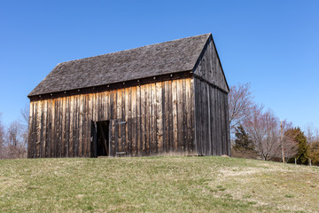 Barn on a hill with door open