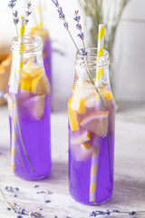 Fresh violet cocktail with lemon, ice and lavender