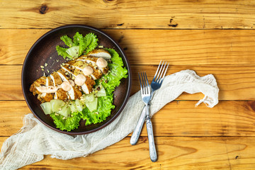 Chicken salad with pineapple, lettuce, cream sauce and walnut