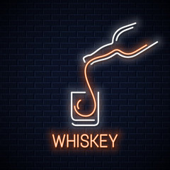 whiskey glass neon banner. Bottle of whisky neon sign on black wall background