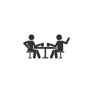 Talking friends at the table icon. Simple glyph vector of friendship set icons for UI and UX, website or mobile application