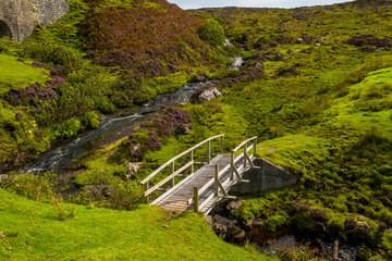 Small Wooden Bridge Over Wild Creek On The Isle Of Skye In Scotland