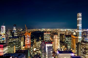 Aerial view of the spectacular Manhattan skyline illuminated at night. New York City, USA.